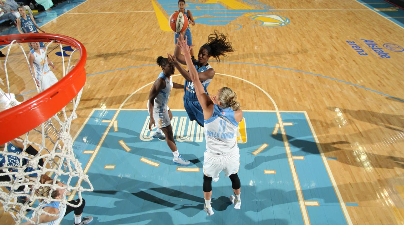 ROSEMONT, IL - JULY 10:  Devereaux Peters #14 of the Minnesota Lynx goes to the basket against the Chicago Sky on July 10, 2015 at Allstate Arena in Rosemont, Illinois. (Photo by Gary Dineen/NBAE via Getty Images)