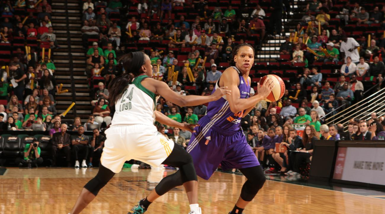 SEATTLE, WA - JULY 10: Monique Currie #25 of the Phoenix Mercury looks to move the ball against the Seattle Storm during the game on June 25, 2015 at KeyArena in Seattle, Washington. (Photo by Joshua Huston/NBAE via Getty Images)