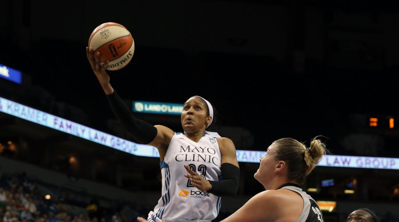 MINNEAPOLIS, MN- JULY 12: Maya Moore #23 of the Minnesota Lynx drives to the basket against the San Antonio Stars on July 12, 2015 at Target Center in Minneapolis, Minnesota. (Photo by Jordan Johnson/NBAE via Getty Images)