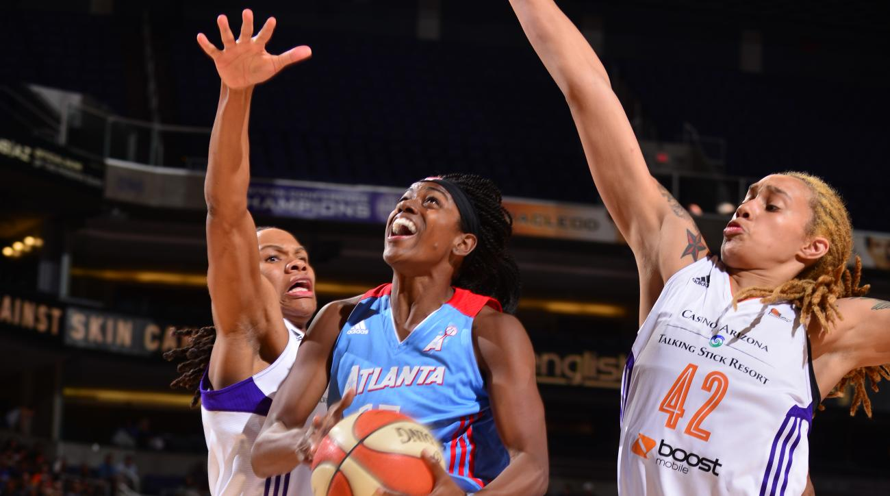 PHOENIX, AZ - JULY 14: Tiffany Hayes #15 of the Atlanta Dream shoots against Monique Currie #25 and Brittney Griner #42 of the Phoenix Mercury on July 14, 2015 at US Airways Center in Phoenix, Arizona. (Photo by Barry Gossage/NBAE via Getty Images)