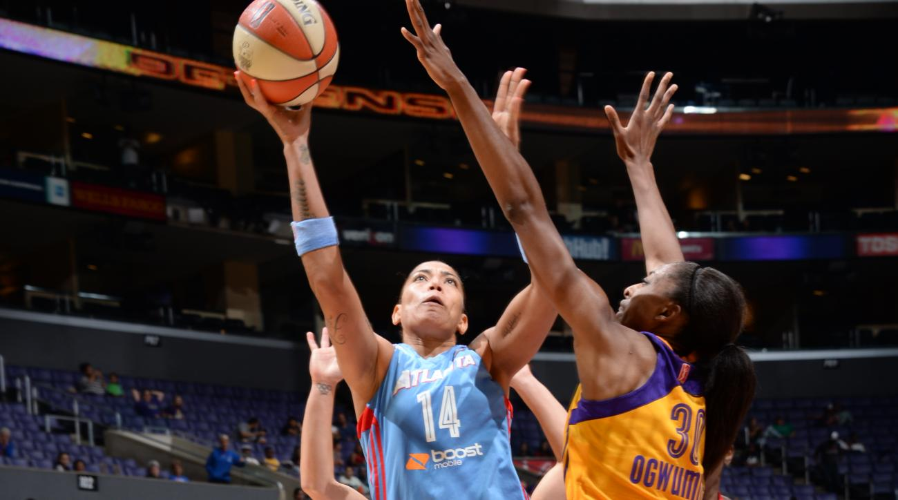 LOS ANGELES, CA - JULY 16: Erika de Souza #14 of the Atlanta Dream shoots against the Los Angeles Sparks on July 16, 2015 at STAPLES Center in Los Angeles, California. (Photo by Andrew D. Bernstein/NBAE via Getty Images)