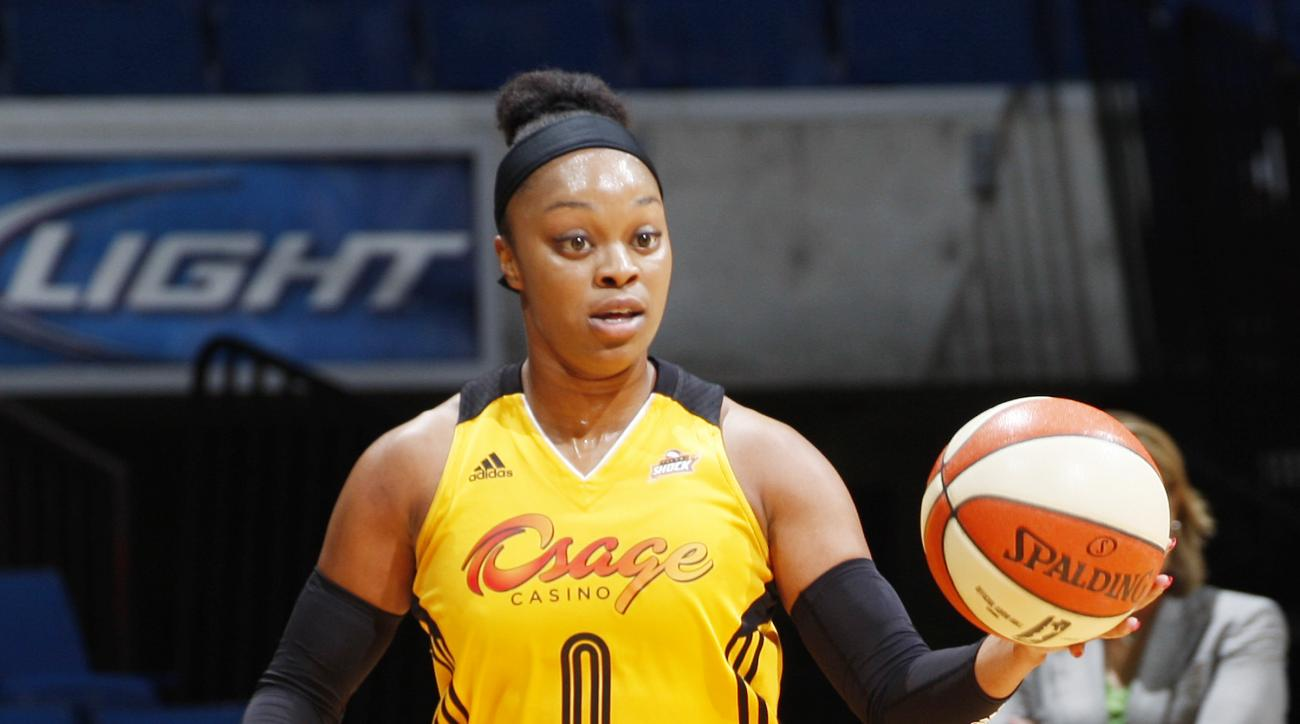 TULSA, OK - JULY 19:  Odyssey Sims #0 of the Tulsa Shock handles the ball against the Minnesota Lynx on July 19, 2015 at the BOK Center in Tulsa, Oklahoma.  (Photo by Shane Bevel/NBAE via Getty Images)