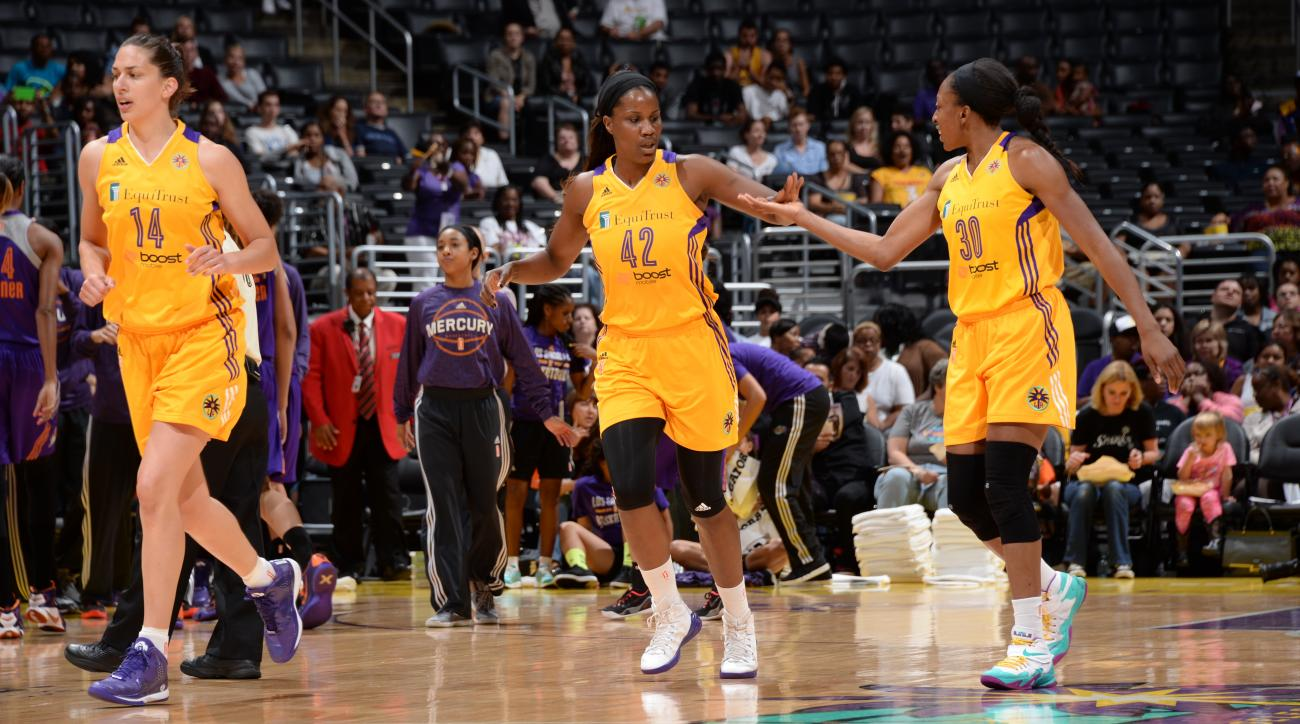 LOS ANGELES, CA - JULY 21:  Jantel Lavender #42 of the Los Angeles Sparks high fives teammate Nneka Ogwumike #30 during the game against the Phoenix Mercury on July 21, 2015 at Staples Center in Los Angeles, California. (Photo by Andrew D. Bernstein/NBAE