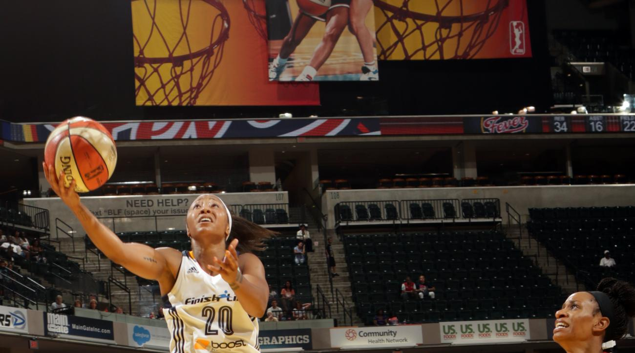 INDIANAPOLIS - AUGUST 2: Briann January #20 of the Indiana Fever goes for the lay up against the Connecticut Sun on August 2, 2015 at Bankers Life Fieldhouse in Indianapolis, Indiana.  (Photo by Ron Hoskins/NBAE via Getty Images)