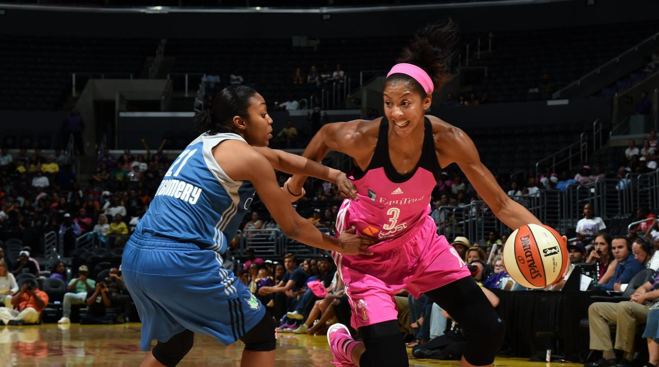 LOS ANGELES, CA - AUGUST 4: Candace Parker #3 of the Los Angeles Sparks drives to the basket against Renee Montgomery #21 of the Minnesota Lynx on August 4, 2015 at Staples Center in Los Angeles, California. (Photo by /NBAE via Getty Images)