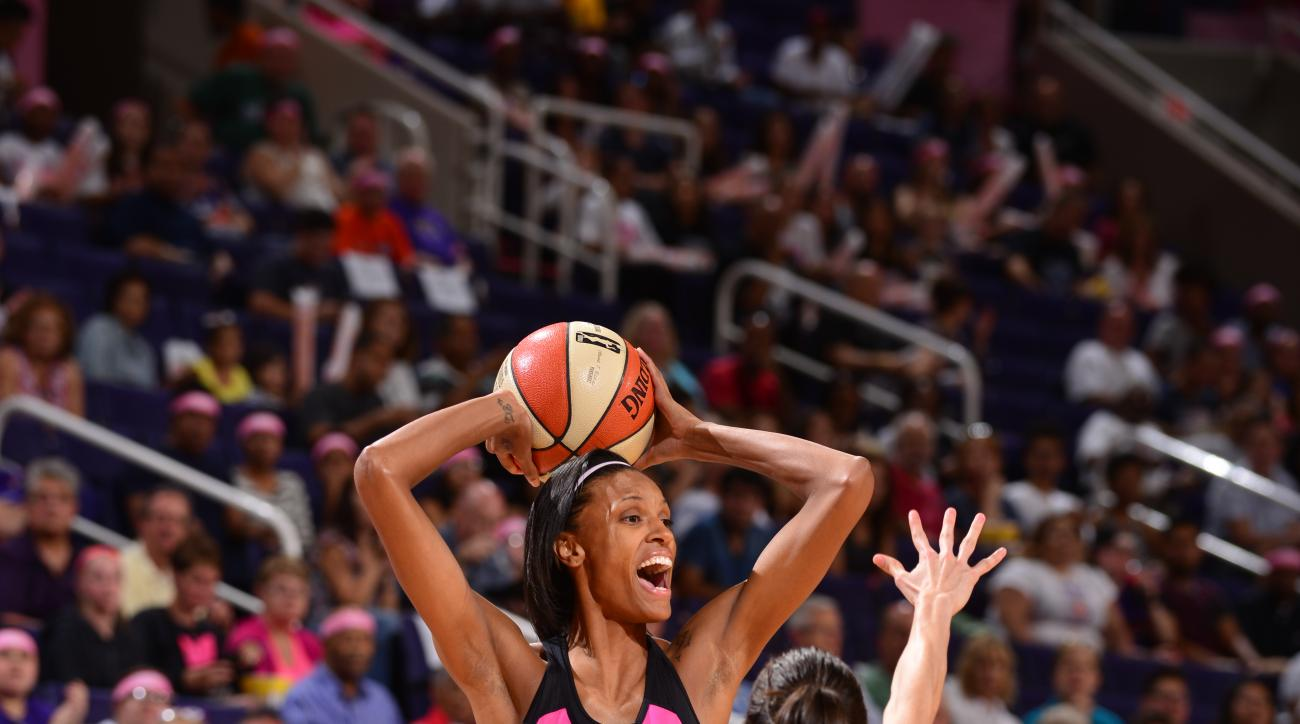 PHOENIX, AZ - AUGUST 7: DeWanna Bonner #24 of the Phoenix Mercury handles the ball against the Minnesota Lynx on August 7, 2015 at US Airways Center in Phoenix, Arizona. (Photo by Barry Gossage/NBAE via Getty Images)