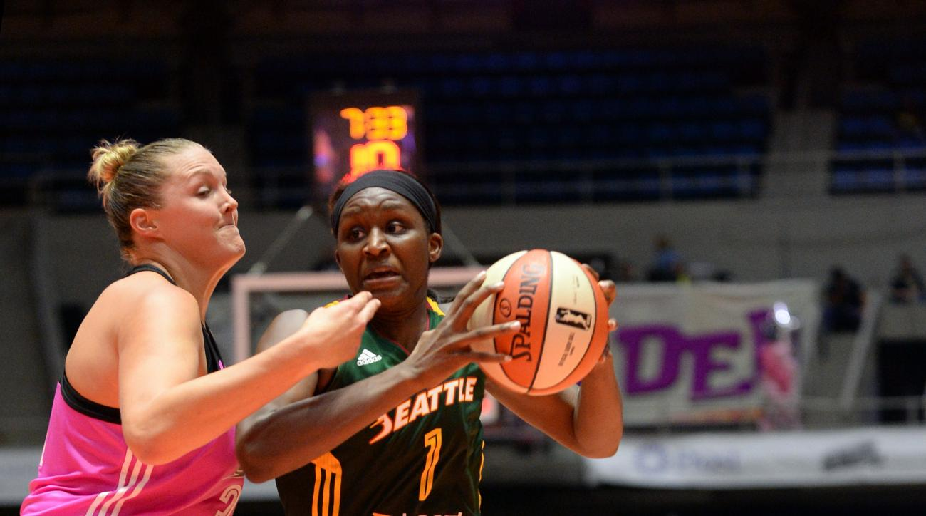 SAN ANTONIO - AUGUST 8: Crystal Langhorne #1 of the Seattle Storm drives to the basket against the San Antonio Stars on August 8, 2015 at the Freeman Coliseum in San Antonio, Texas.