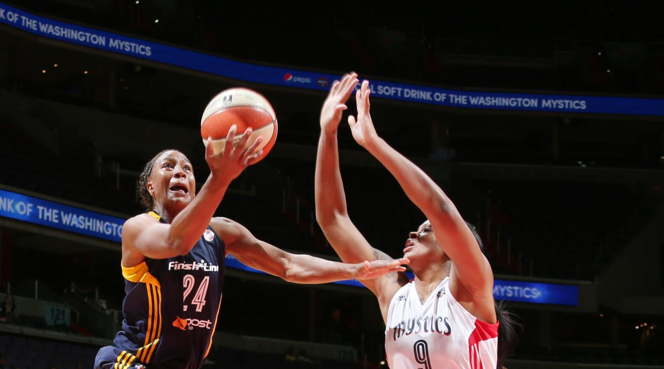 WASHINGTON, DC - AUGUST 11:  Tamika Catchings #24 of the Indiana Fever goes up for a shot against the Washington Mystics at the Verizon Center on August 11, 2015 in Washington, DC. (Photo by Ned Dishman/NBAE via Getty Images)