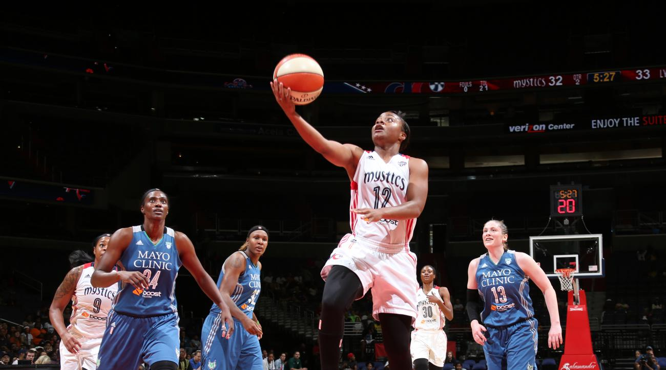 WASHINGTON, DC - AUGUST 16: Ivory Latta #12 of the Washington Mystics goes for the lay up against the Minnesota Lynx on August 16, 2015 at the Verizon Center in Washington, DC. (Photo by Ned Dishman/NBAE via Getty Images)