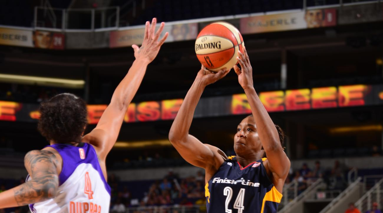PHOENIX, AZ - AUGUST 16: Tamika Catching #24 of the Indiana Fever shoots against Candice Dupree #4 of the Phoenix Mercury on August 16, 2015 at the US Airways Center in Phoenix, Arizona. (Photo by Barry Gossage/NBAE via Getty Images)