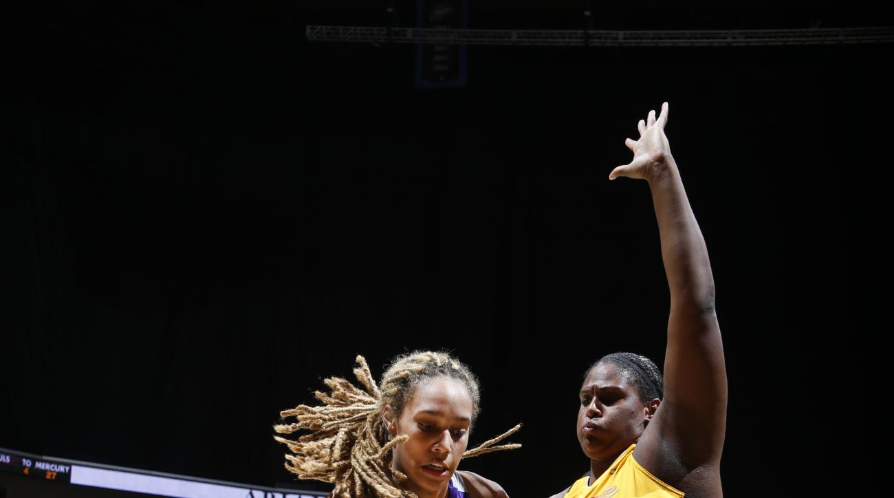 TULSA, OK - AUGUST 18: Brittney Griner #42 of the Phoenix Mercury handles the ball against Courtney Paris #3 of the Tulsa Shock on August 18, 2015 at the BOK Center in Tulsa, Oklahoma.  (Photo by Shane Bevel/NBAE via Getty Images)