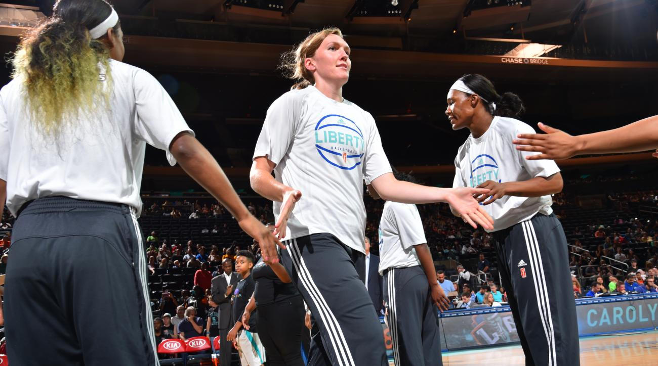 NEW YORK, NY - AUGUST 21: Carolyn Swords #8 of the New York Liberty walks onto the court during player introductions before a game against the Atlanta Dream on August 21, 2015 at Madison Square Garden in New York City, NY. (Photo by Jesse D. Garrabrant/NB