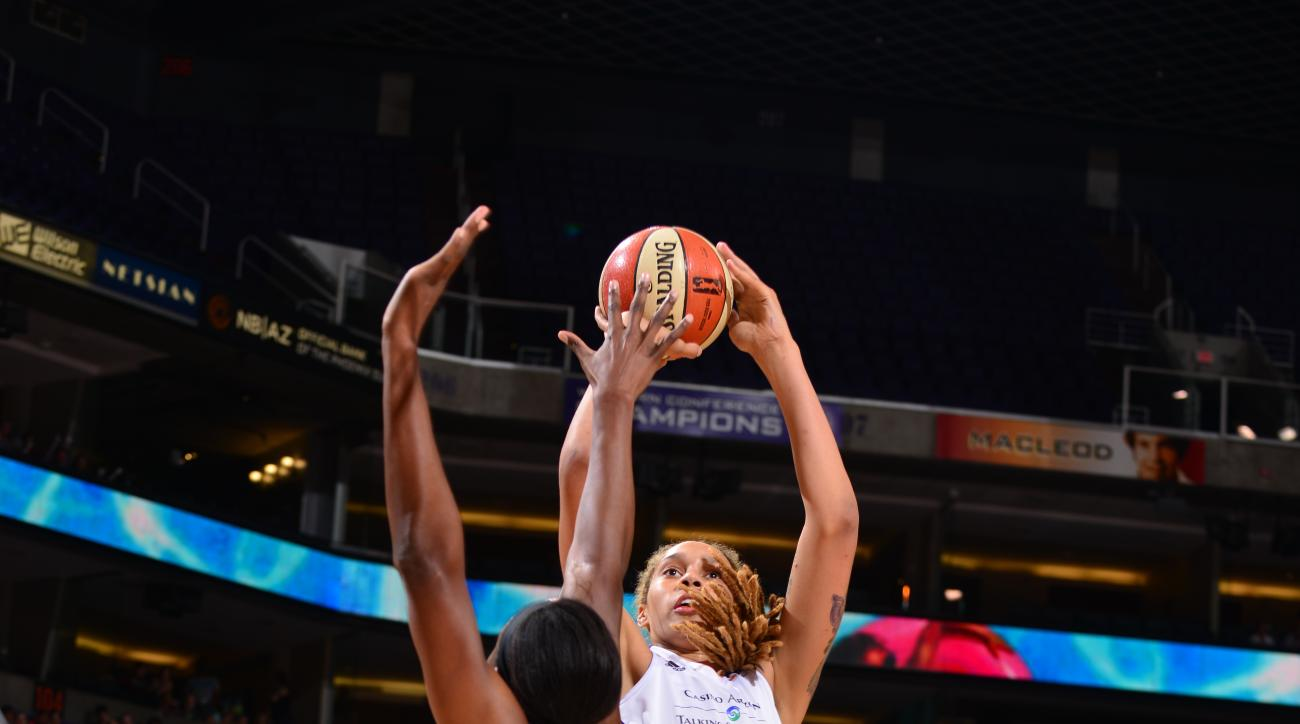 PHOENIX, AZ - AUGUST 23: Brittney Griner #42 of the Phoenix Mercury shoots against Sylvia Fowles #34 of the Minnesota Lynx on August 23, 2015 in Phoenix, Arizona. (Photo by Barry Gossage/NBAE via Getty Images)