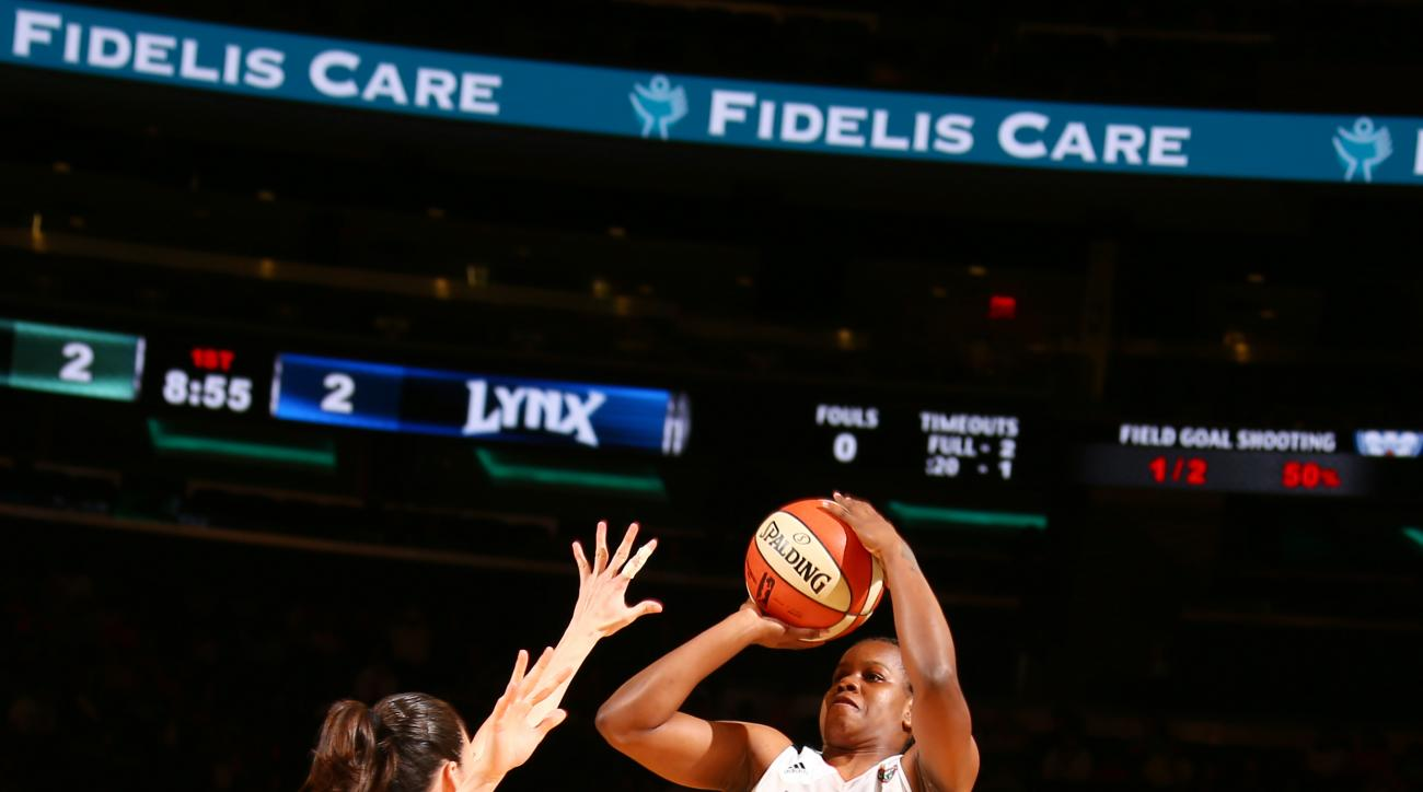 NEW YORK, NY - AUGUST 28: Epiphanny Prince #10 of the New York Liberty shoots during a game against the Minnesota Lynx on August 28, 2015 at Madison Square Garden, New York City , New York.  (Photo by Nathaniel S. Butler/NBAE via Getty Images)