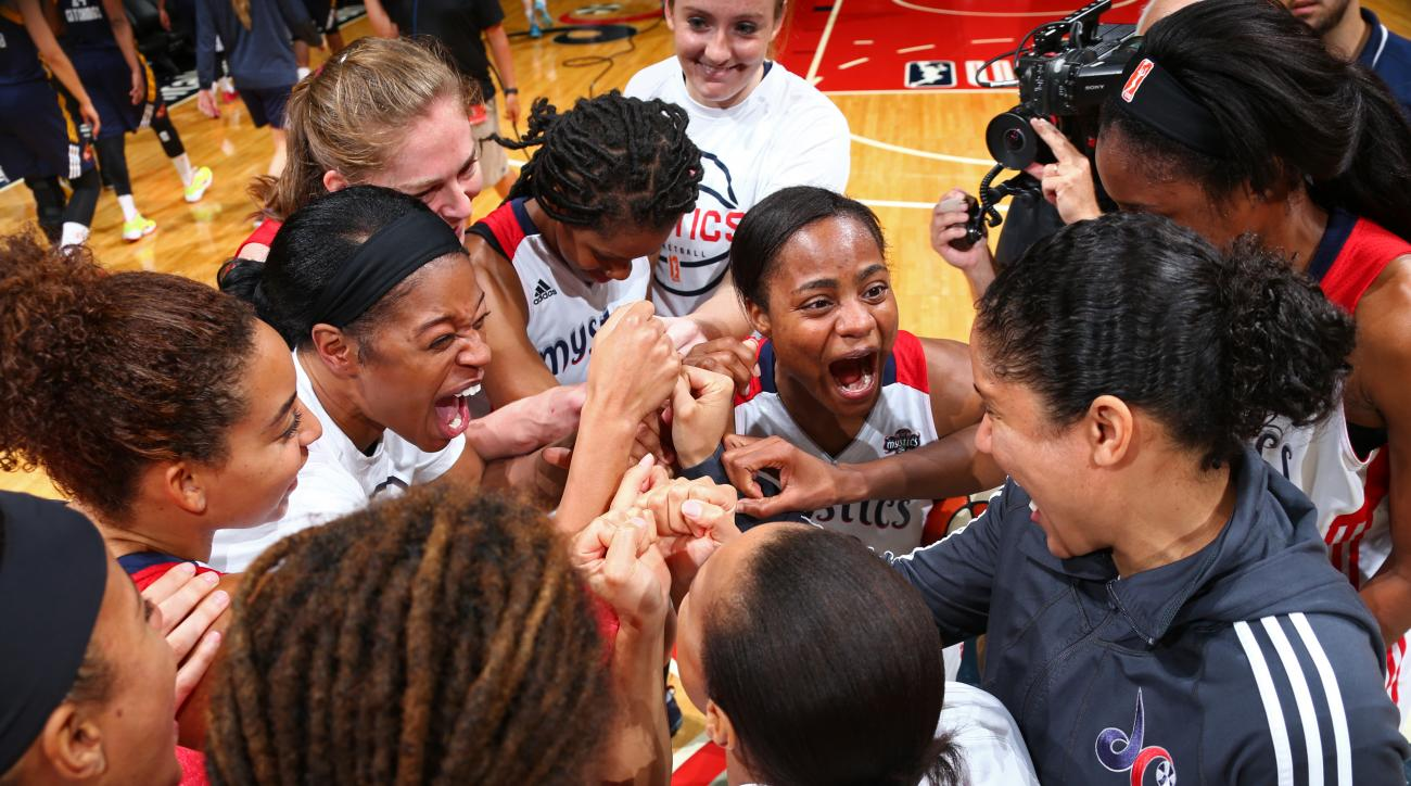 WASHINGTON, DC - SEPTEMBER 08:  Ivory Latta #12 of the Washington Mystics celebrates after the game against the Indiana Fever on September 8, 2015 at the Verizon Center in Washington, DC. (Photo by Ned Dishman/NBAE via Getty Images)
