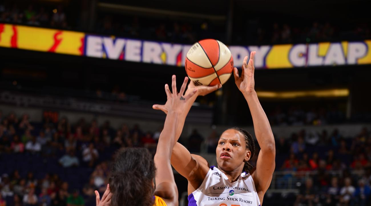 PHOENIX, AZ - SEPTEMBER 11: Monique Currie #25 of the Phoenix Mercury shoots against Farhiya Abdi #13 of the Los Angeles Sparks on September 11, 2015 at the US Airways Center in Phoenix, Arizona. (Photo by Barry Gossage/NBAE via Getty Images)