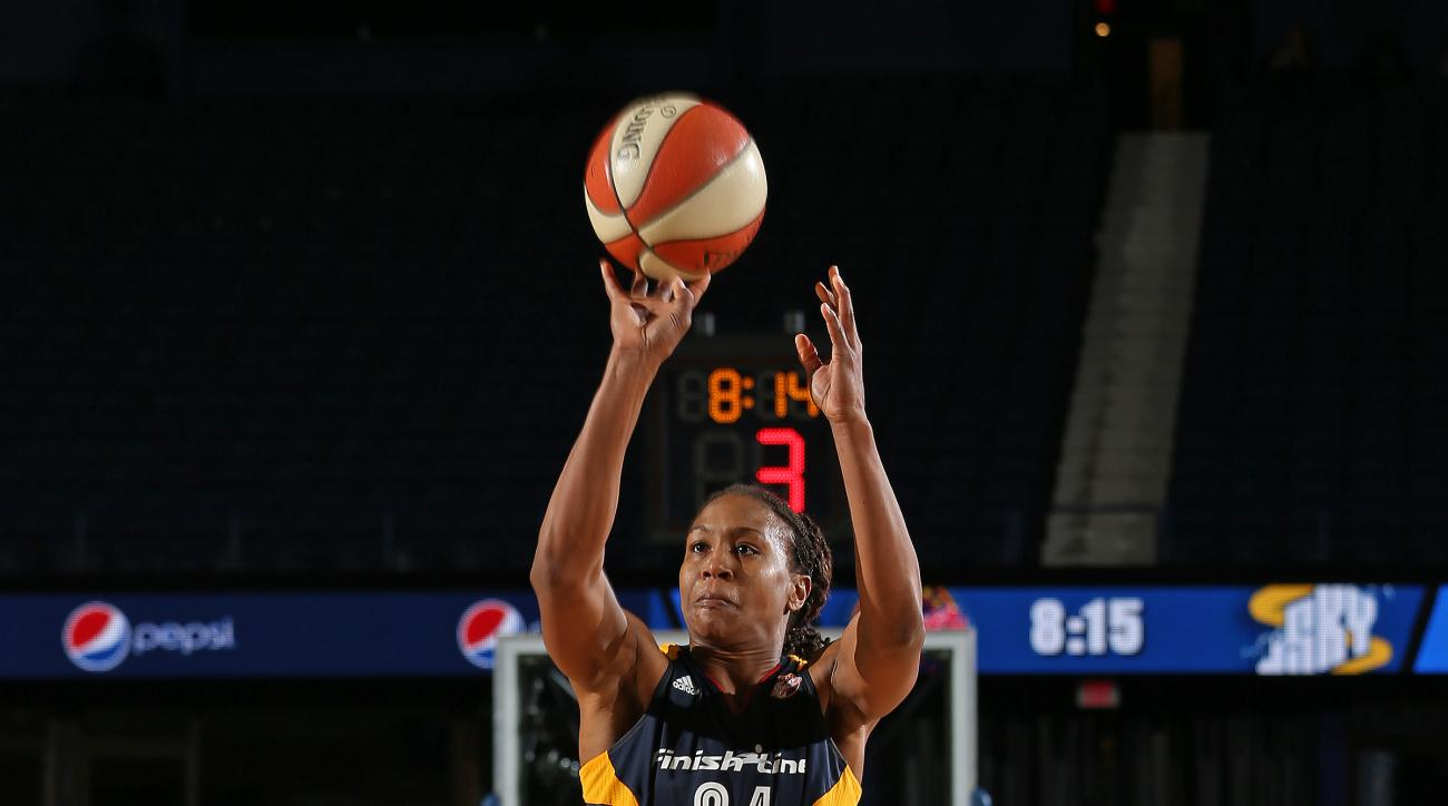ROSEMONT, IL - SEPTEMBER 17:  Tamika Catchings #24 of the Indiana Fever shoots the ball against the Chicago Sky during Game Three of the Eastern Conference Semifinals on September 21, 2015 at Allstate Arena in Chicago, Illinois. (Photo by Gary Dineen/NBAE