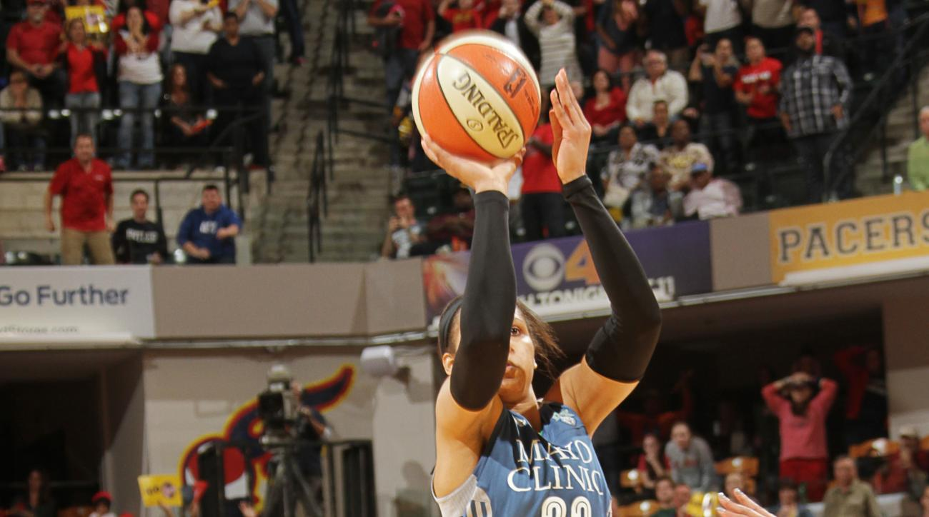 INDIANAPOLIS, IN - OCTOBER 9:  Maya Moore #23 of the Minnesota Lynx takes the game winning shot during Game Three of the 2015 WNBA Finals against the Indiana Fever on October 9, 2015 at Bankers Life Fieldhouse in Indianapolis, Indiana. (Photo by Ron Hoski