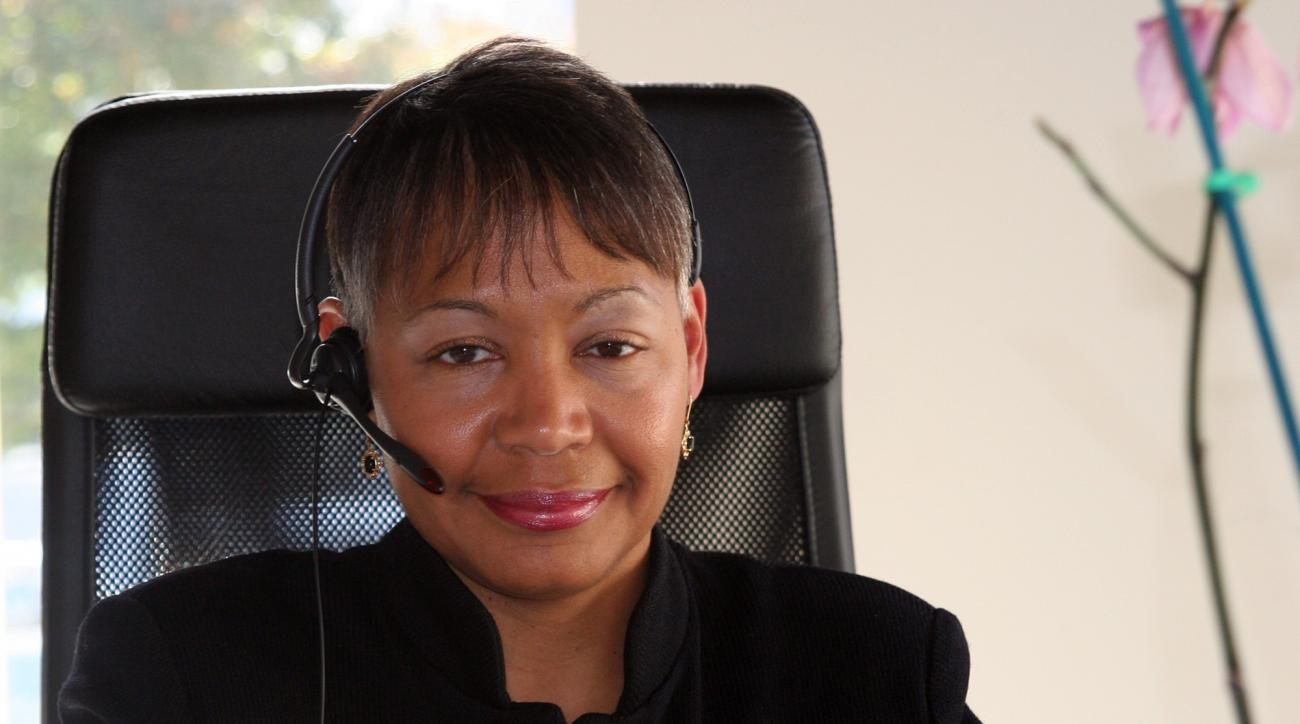 FILE - In this Oct. 28, 2009, file photo, Atlanta mayoral candidate Lisa Borders makes calls to supporters in her office at her campaign headquarters in Atlanta. Borders, who helped bring the Dream to Atlanta in 2008 as the city's vice mayor, will become