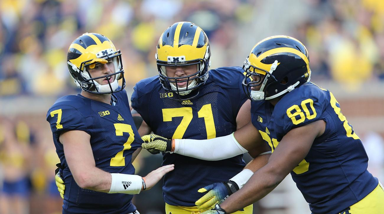 Michigan head coach Brady Hoke is catching heat for putting Shane Morris back into Saturday's game after the QB potentially sustained a head injury.