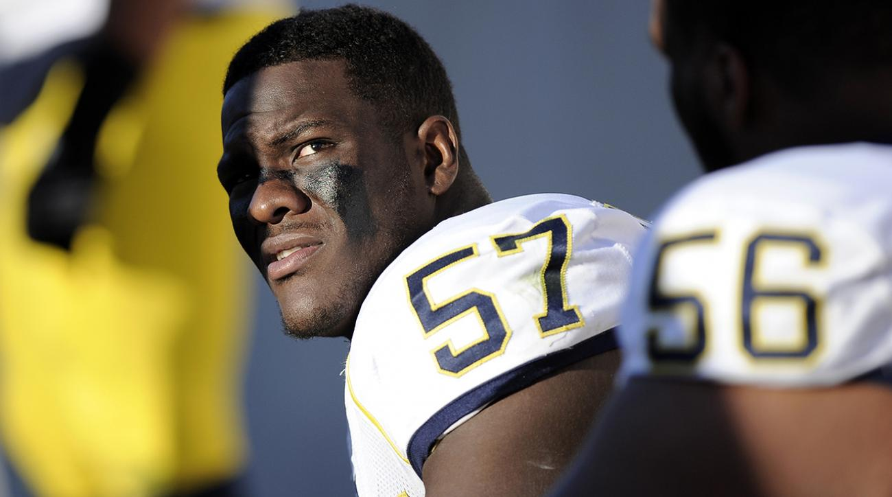Michigan dismisses DE Frank Clark after being charged and arrested with domestic violence