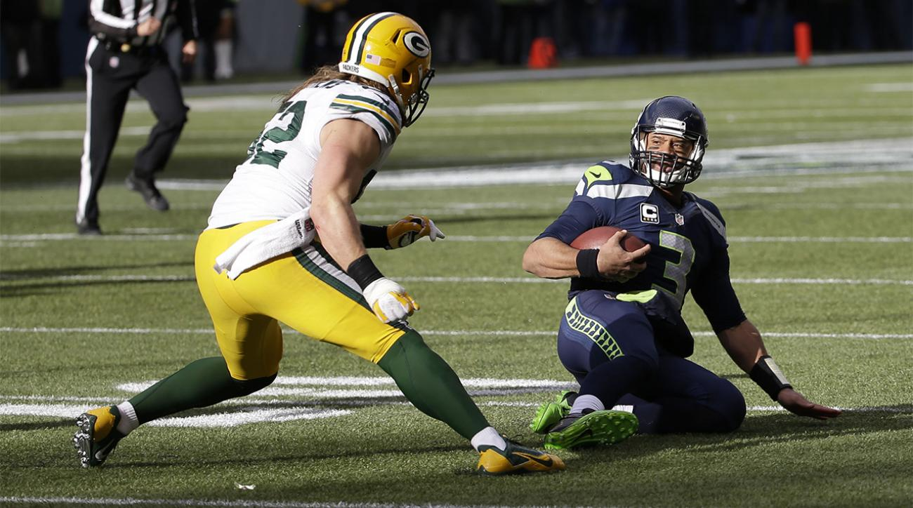Watch Russell Wilson s crushed by Clay Matthews on an illegal