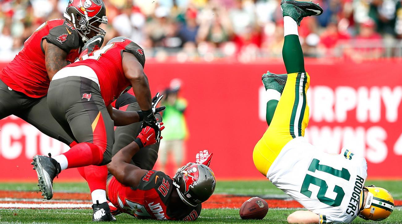 Aaron Rodgers blames calf injury on Tampa Bay field