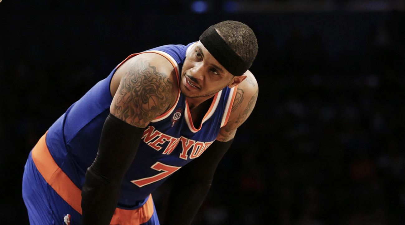 Carmelo Anthony leaves game early, knee injury may end season