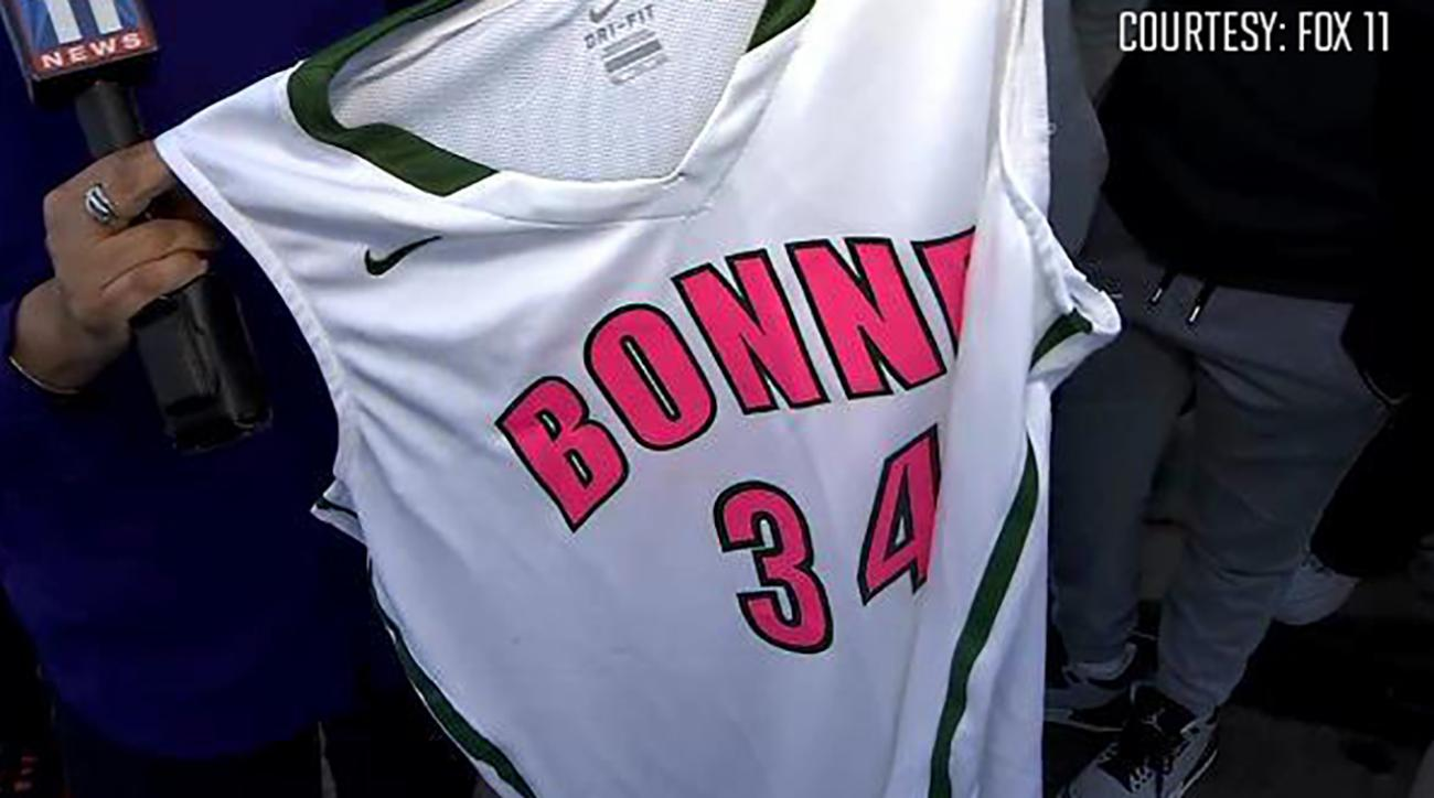 Girls' hoops team disqualified for pink-lettered uniforms