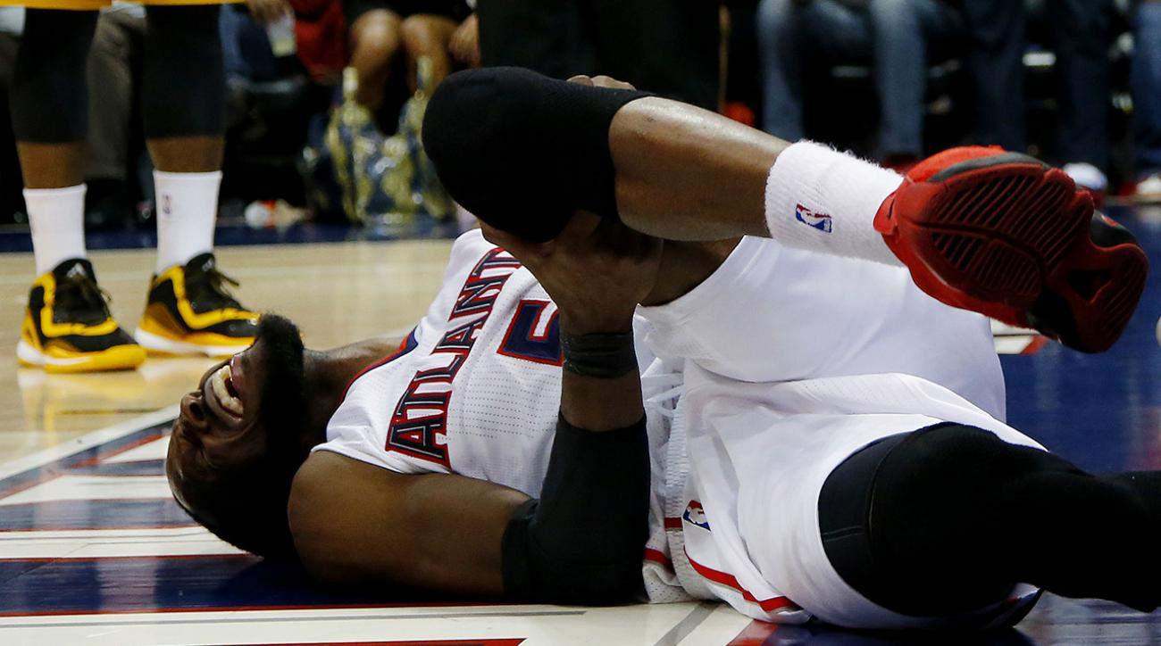 Hawks lose forward DeMarre Carroll late in Game 1 with left leg injury