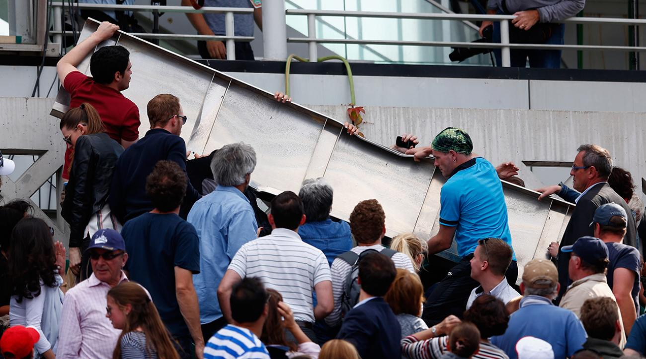 Three spectators injured by falling metal sheet at French Open