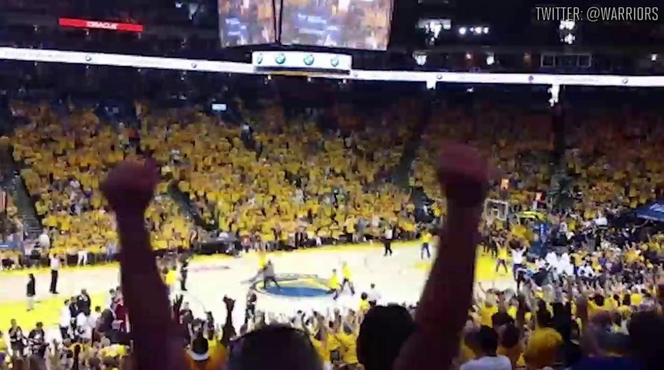 Warriors fan hits half-court shot at halftime to win BMW