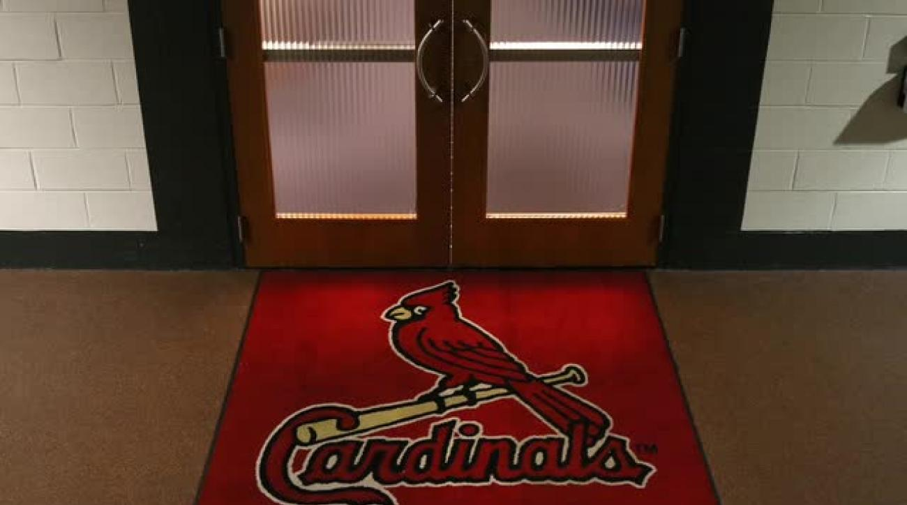 Cardinals fire scouting director amid federal investigation
