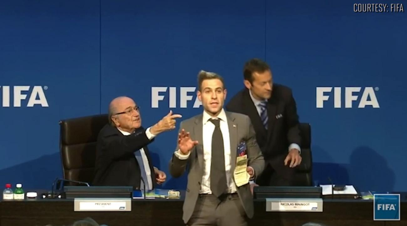 Prankster interrupts Sepp Blatter press conference IMAGE