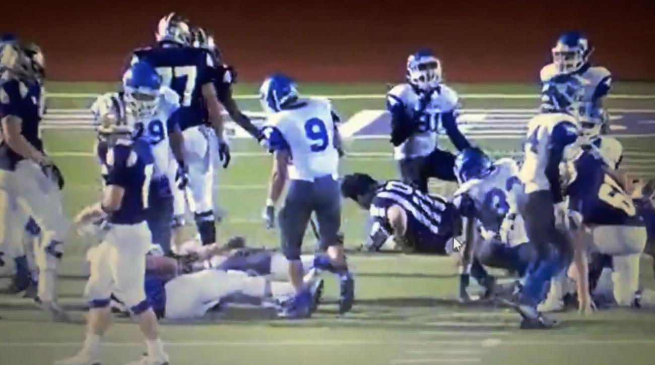 Police investigating two Texas high school football players who hit ref