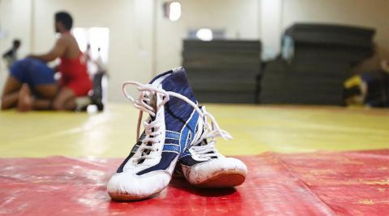 Iowa High School Wrestler Dies After Collapsing During Tournament