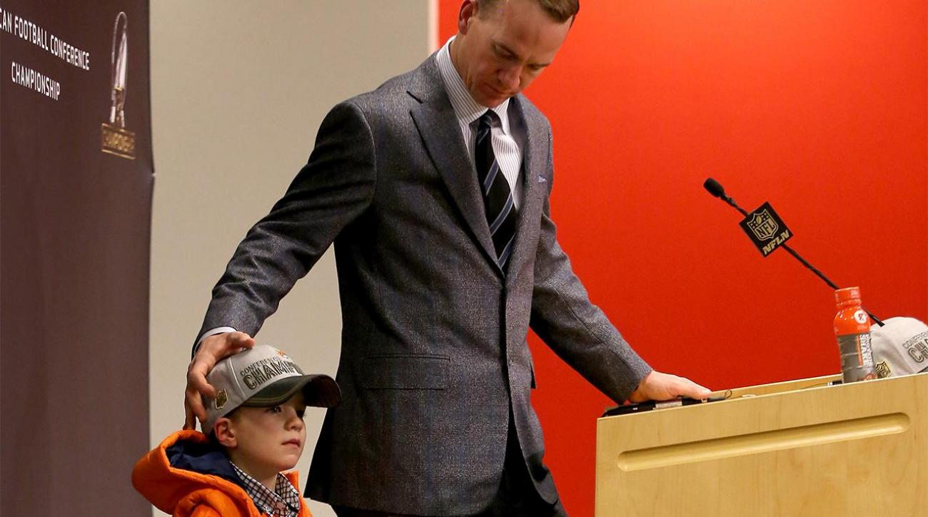 Peyton Manning joined by his 4-year-old son at press conference