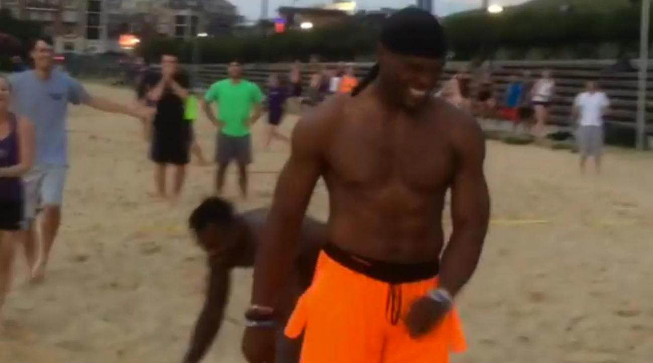 Mustard Minute: Cam Newton's beach volleyball skills need work; gets blocked by girl IMG