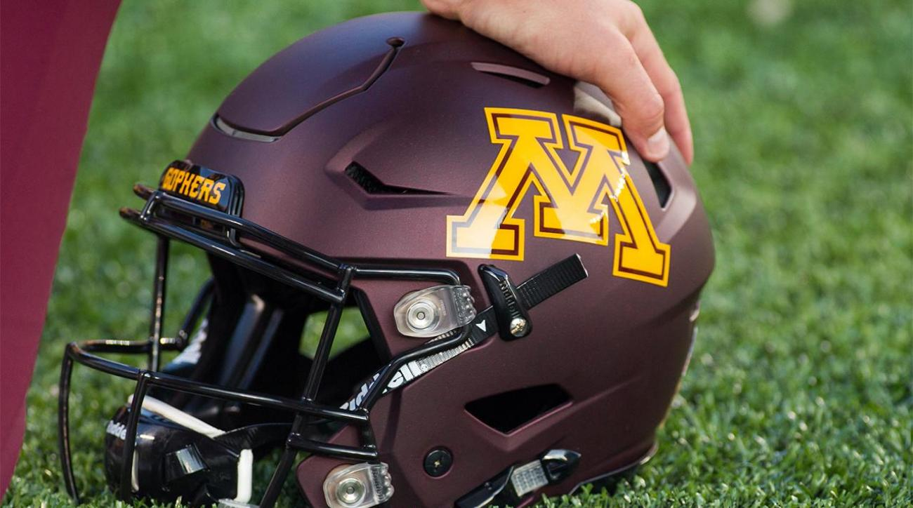 Minnesota suspends 10 football players indefinitely