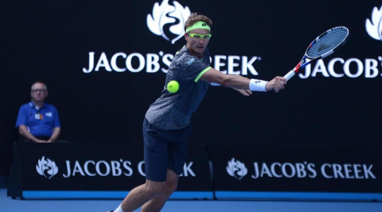 Six-time champ Novak Djokovic stunned by qualifier Denis Istomin at Australian Open