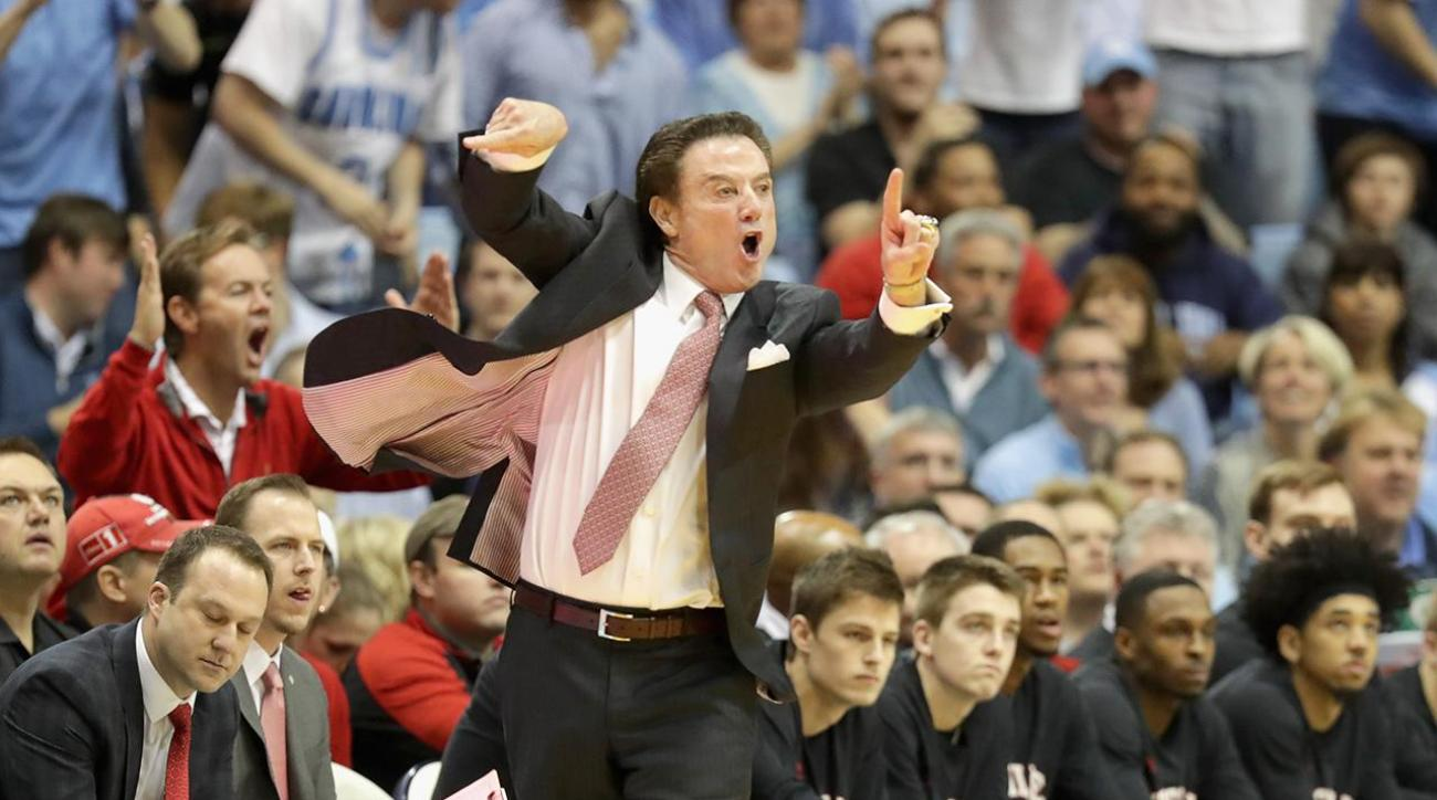 Rick Pitino restrained after verbal exchange with UNC fan