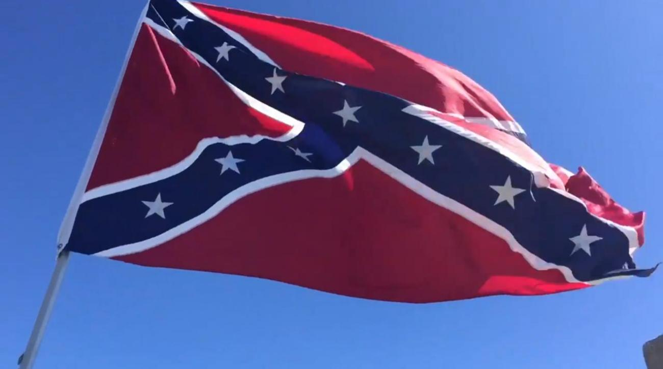 Protesters fly Confederate flag next to NCAA tournament arena in South Carolina