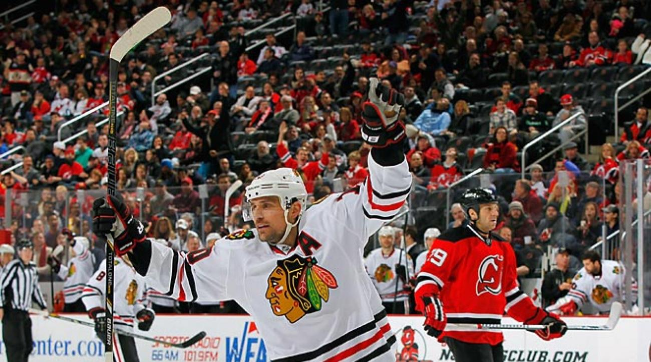 Sharp nets another hat trick, Blackhawks top Devils