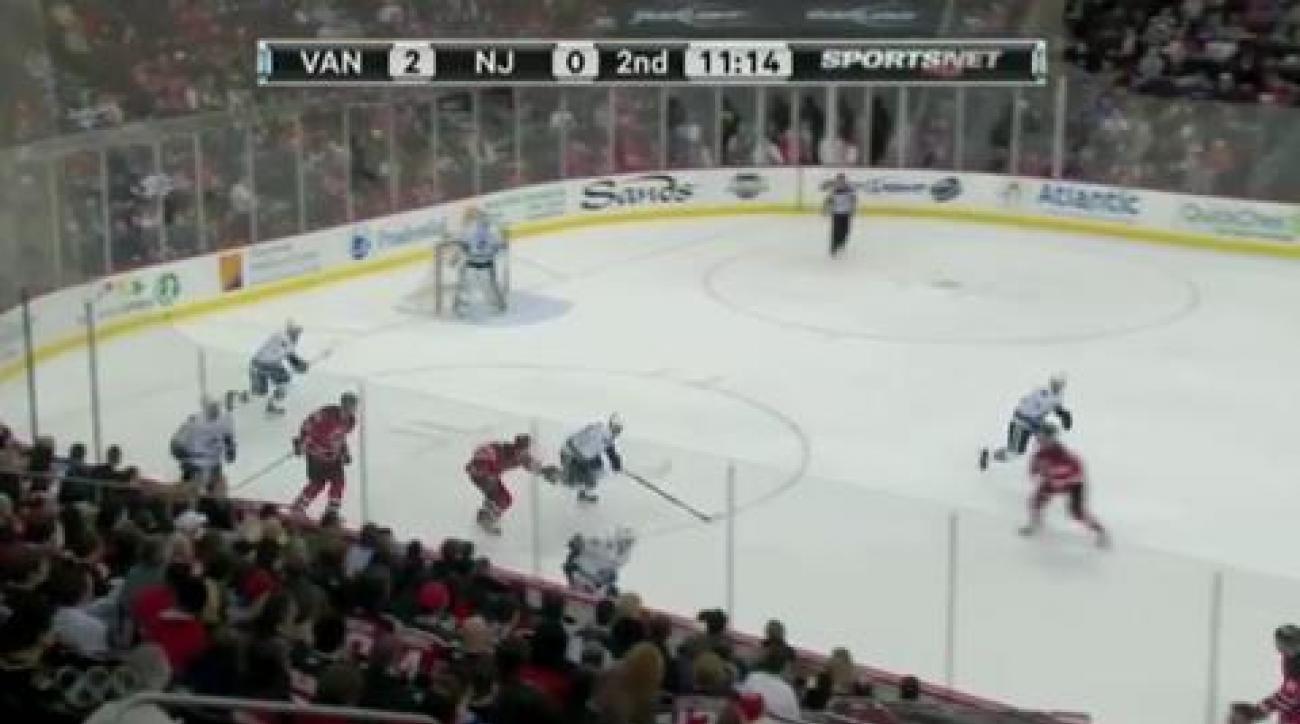 Canucks down Devils for NHL lead