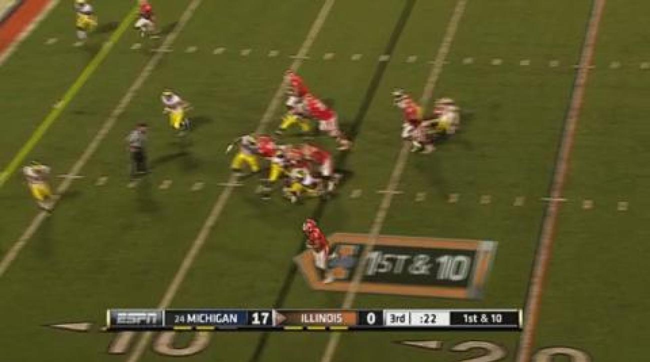 Toussaint, No. 22 Michigan defeats Illinois 31-14