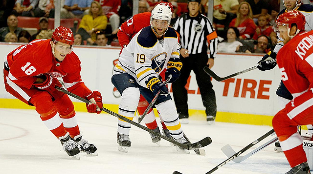 Red Wings hold off Sabres in season debut