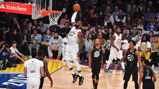 LOS ANGELES, CA - FEBRUARY 18: LeBron James #23 of Team LeBron goes up for the dunk against Team Curry during the NBA All-Star Game as a part of 2018 NBA All-Star Weekend at STAPLES Center on February 18, 2018 in Los Angeles, California. NOTE TO USER: User expressly acknowledges and agrees that, by downloading and/or using this photograph, user is consenting to the terms and conditions of the Getty Images License Agreement. Mandatory Copyright Notice: Copyright 2018 NBAE (Photo by Jesse D. Garrabrant/NBAE via Getty Images)
