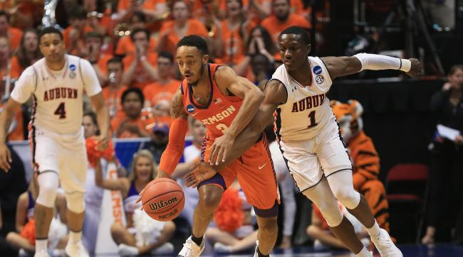 SAN DIEGO, CA - MARCH 18:  Marcquise Reed #2 of the Clemson Tigers drives against Jared Harper #1 of the Auburn Tigers in the first half during the second round of the 2018 NCAA Men's Basketball Tournament at Viejas Arena on March 18, 2018 in San Diego, California.  (Photo by Sean M. Haffey/Getty Images)