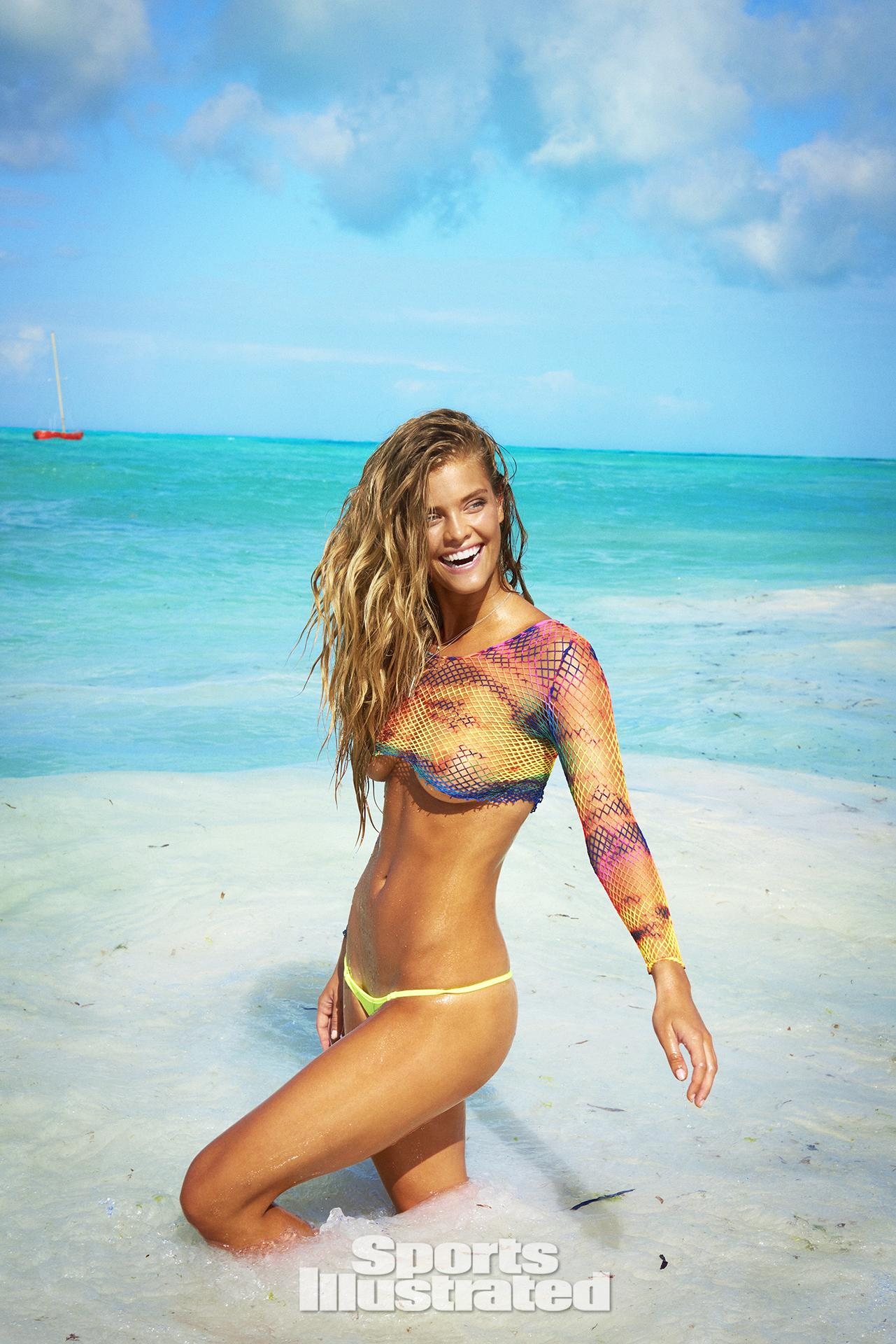 Nina Agdal was photographed by Ruven Afanador in Zanzibar. Top by We Love Colors. Swimsuit by TeenyB Bikini Couture.