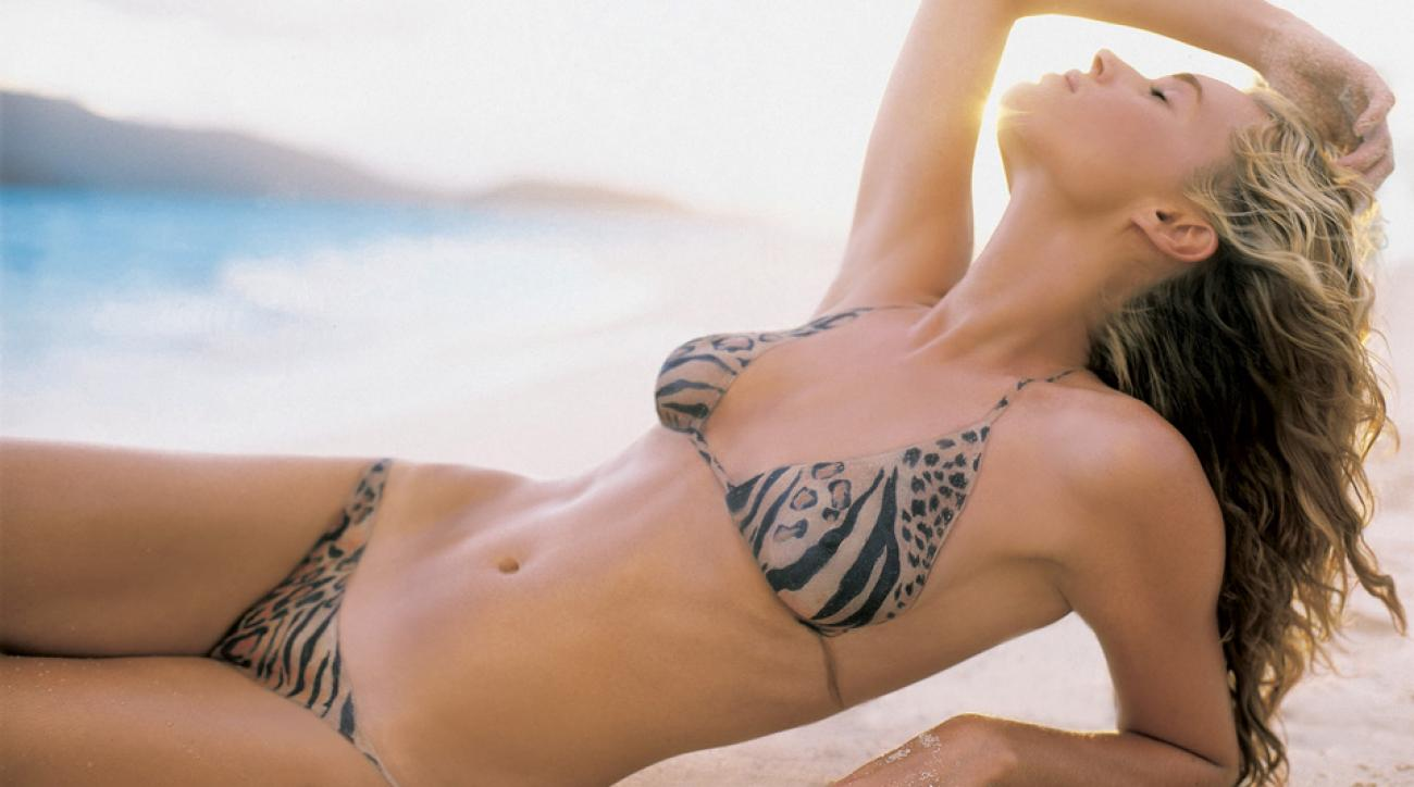 Rebecca Romijn on beach in body-painted version of bikini by Bendigo.